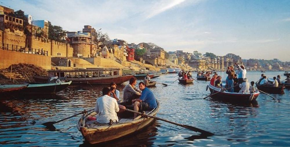 Experience a languid boat ride alongside the bustling ghats of Varanasi